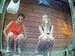 Hidden camera catches two hot chicks pissing