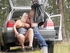 Blonde woman blowjob in forest