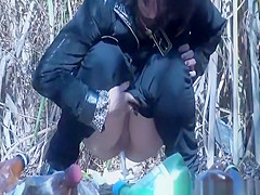 woman squats and pee outdoors