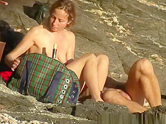 nudist couple enjoying the sunny day