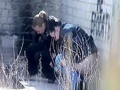 Girls peeing abandon place