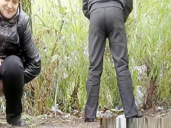 couple peeing outdoors