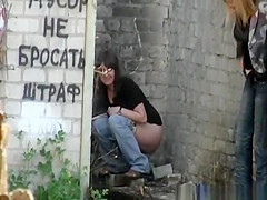 Brunette chick pees outside