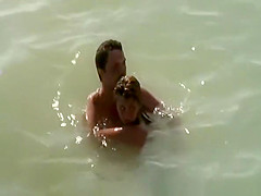 nudist couple caught fucking in the water