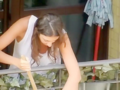 Woman cleaning the apartment tits downblouse