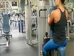 Chick in tight blue spandex pants exercising