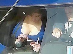 looking into the neckline of a busty girl in the car