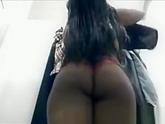 Black woman in red thong
