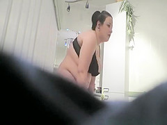 Chubby girl changing in bathroom