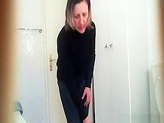 Mature woman spied in bathroom changing