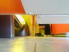 Woman undressing in tanning room