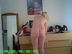 Woman spied in her bedroom dressing