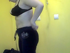 Chubby woman spied in tanning room dressing
