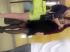 Asian woman in green short skirt