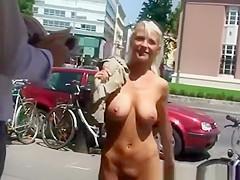 Busty blonde walking naked in public