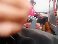 Guy strokes his cock in train