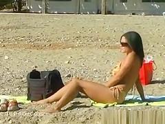 Girl peeing on the beach