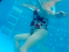 Busty mature woman filmed under water