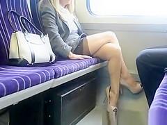 Blonde woman spreads legs in train