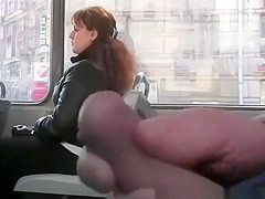 Dude plays with cock in bus
