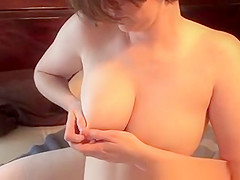 wife with milky boobs squeezes them