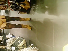 Exhibitionist woman lifts dress in store