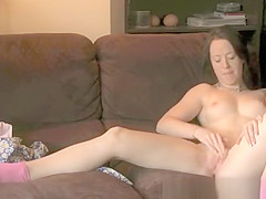 Teen fingering pussy in couch