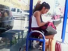 Teen cheerleaders waiting for bus