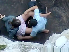 Lovers on Rocky Beach