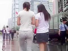 Asian chicks walking in the street
