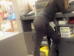 Chick working in store dressing black clothes