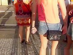 Girl in denim shorts waiting for crossing road