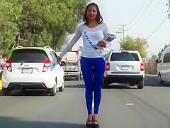 Sexy latina in blue leggings