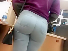 Round ass chick wearing tight light blue jeans
