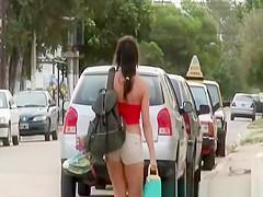 Brunette girl dressing at beach