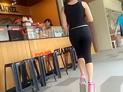 nerd teen in black leggings walking