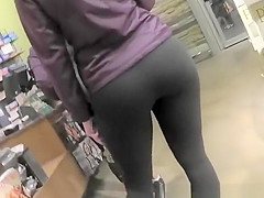 Girl in black leggings and sports shoes