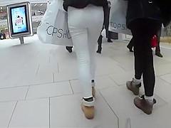 Girls in tight jeans pants walking in the street