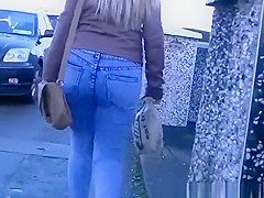 Long hair blonde wearing tight jeans pants