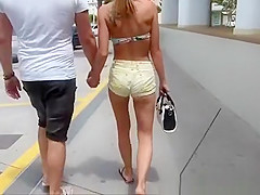 Girl in a sexy shorts to walk around the city