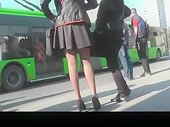 Long hair girl in short black skirt