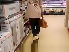 Woman in short dress supermarket upskirt