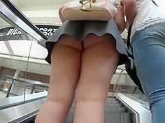 Teen in small skirt has her butt secretly filmed