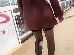 Woman in black stockings going upstairs