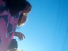 Girl in short skirt upskirted