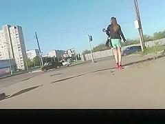 Nice legs chick in short green skirt