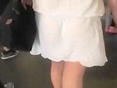 Woman in short see through dress upskirt