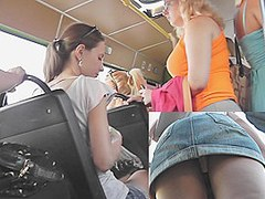Adorable upskirt gal on a bus stop