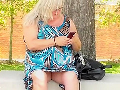 Granny seated at the bus stop upskirt