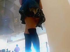Teen in short black skirt upskirt